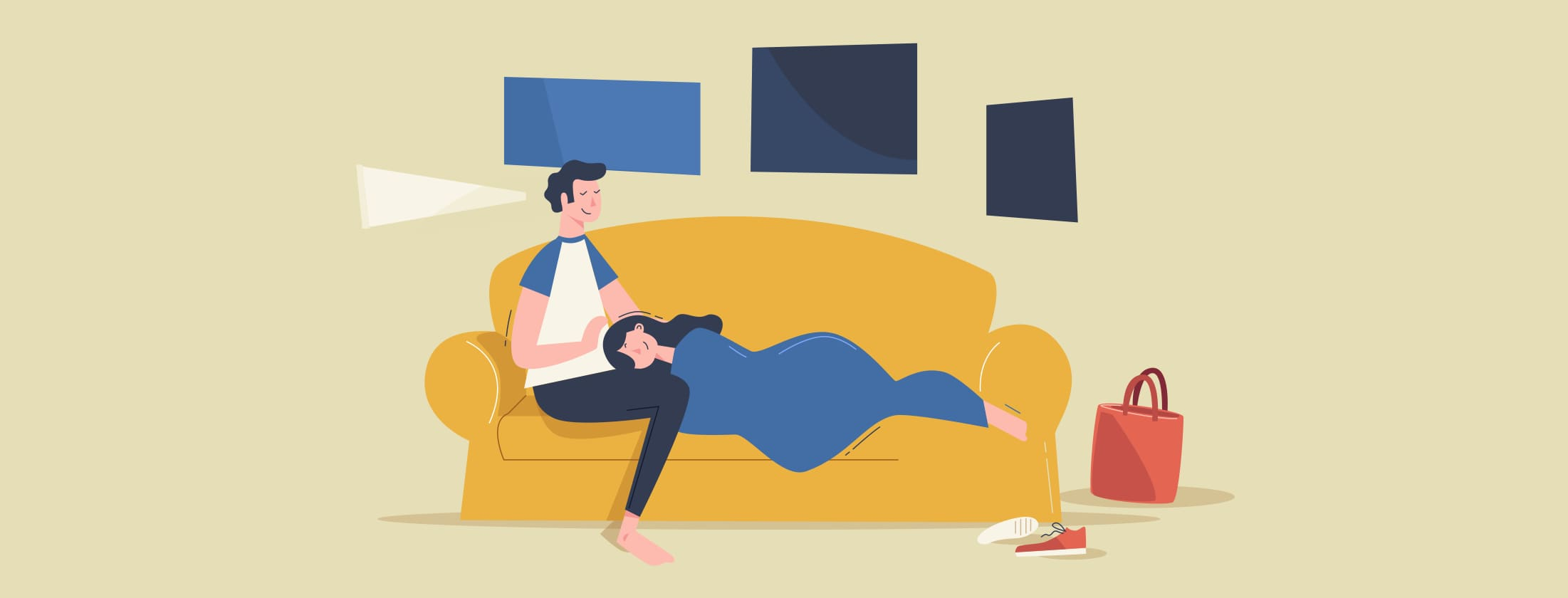 women laying down on couch next to man
