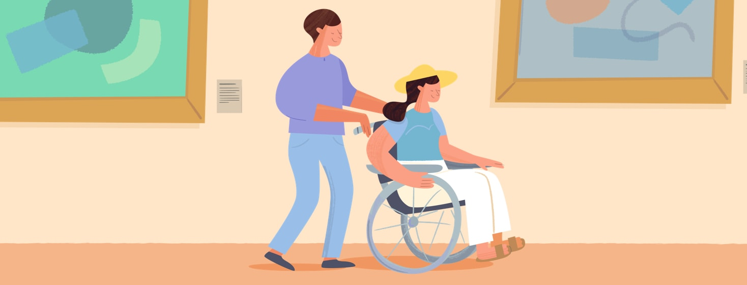 Woman in a wheelchair being pushed through a museum by her friend