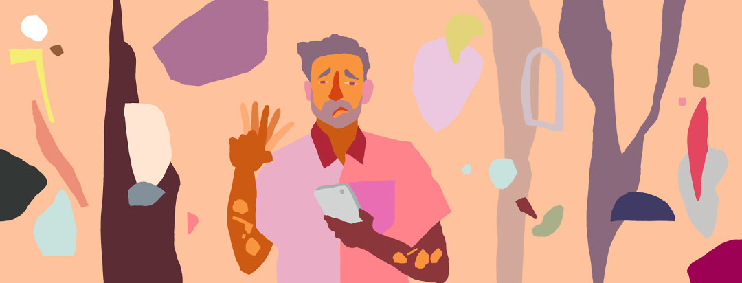 Man with psoriasis looking deflated and waving a finger back and forth in disapproval