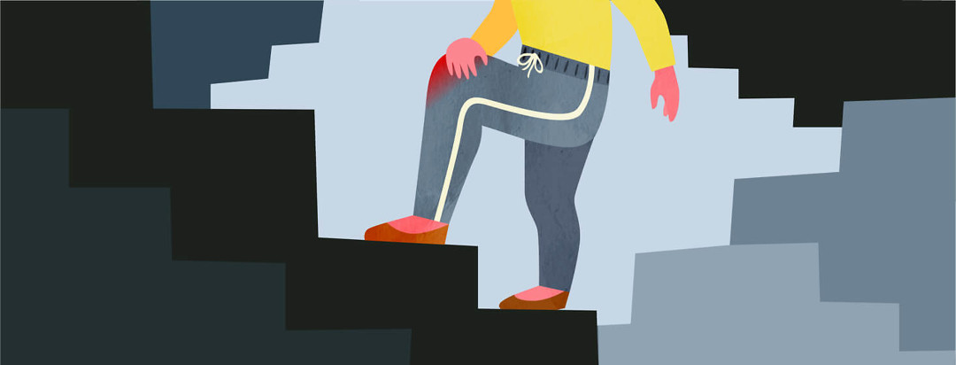 Person walking up stairs clutching their visibly inflamed knee
