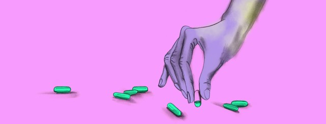 a hand picks up a vitamin pill that is only 25% full