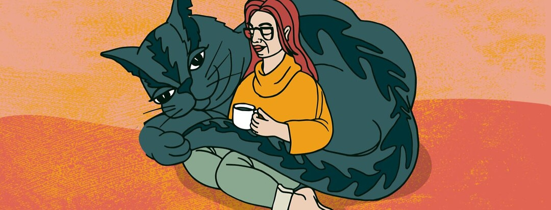 Contented woman drinking tea and being cuddled by her oversized cat