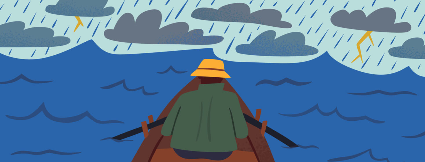A person in a boat navigates a stormy sea